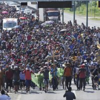A caravan of migrants, mostly from Central America, head north along a coastal highway just outside of Huehuetan, Chiapas State, Mexico, on Sunday, Oct. 24, 2021. (AP Photo/Marco Ugarte)
